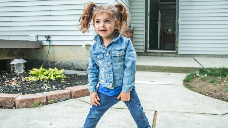 Girl wearing jeans and a denim jacket